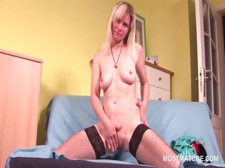 grown-up babe into fishnets riding dildo inside