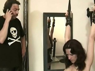 master ties super girl slave with her hands and