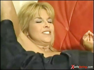 grownup wife drilled on yellow sofa