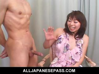 amateur woman in a small skirt jerks and licks a