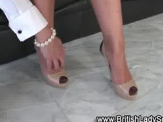 cougar brit femdom shoe posing for the camera