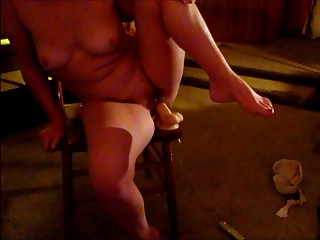 lady pushing dildo large dond=gs and licks cock