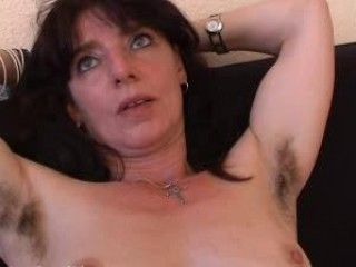 hirsute mature inexperienced in brief spreads her