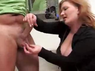 grown-up red-haired gives those fucker a handjob