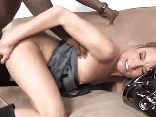 cute blond woman picking up a black fella