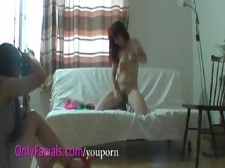 young red-haired woman takes facial