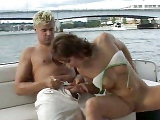 delightful woman lady shags wildly on the boat