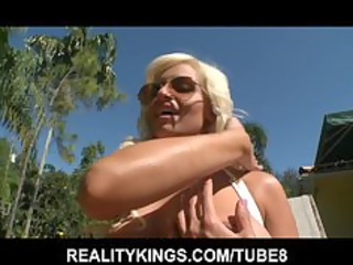 sun tanning pale exposes off her giant bossom and