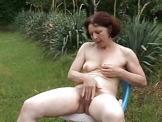 old mature masturbing inside garden