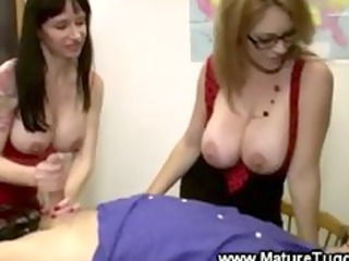 large breasted matures are tugging a dick