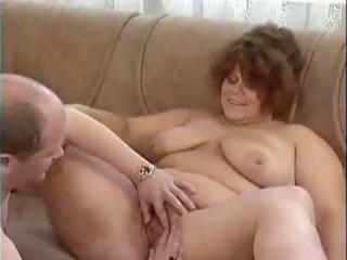 plump brunette elderly eats a stiff rod and