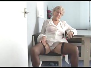 attractive elderly into small dress goes naked