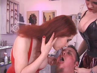 two redhaired dominatrix torment slave through