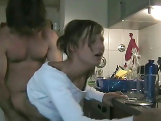cheating babe copulates fucker into the kitchen