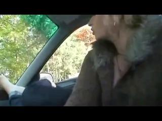 older girl giving footjob inside car by troc