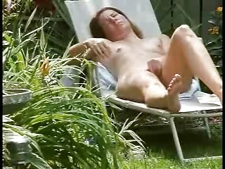spying my sweet milf dildoing in court yard