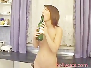 horny lady sicking bottle neck inside her pussy