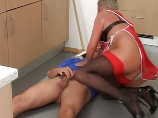 grey haired elderly into green top pantyhose