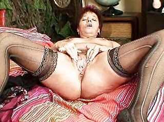elderly inexperienced lady squeezing her vagina