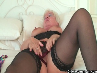 curvy elderly in brown pantyhose rubs her granny