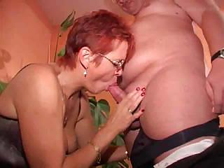red-haired elderly into stockings copulates