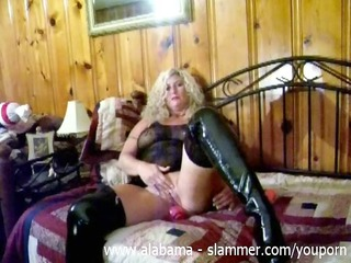 woman wipes her clit with sex toy