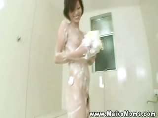 timid awesome oriental babe soaping herself up