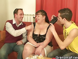 fat mature lady takes two young cocks from both