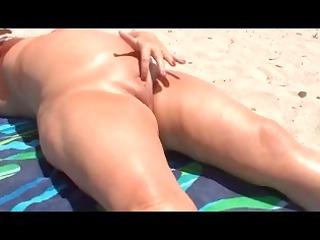 old touching herself on the shore