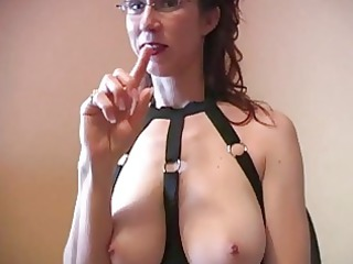 horny ginger woman with glasses does titjob with