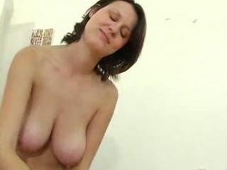 older lady with giant boobs gives a handjob