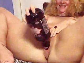 grown-up puts a bottle into her gang bang hole