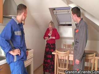 nasty elderly spreads her foot for two dicks