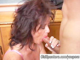 gorgeous grown-up chick gives a cock licking