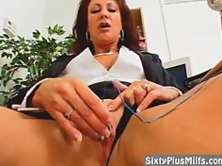 elderly awesome lady dildoing into the office