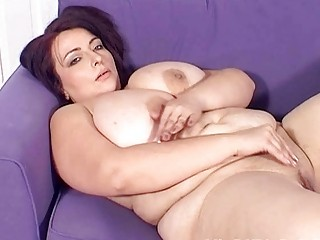 large breasted milf lady masturbates on the sofa