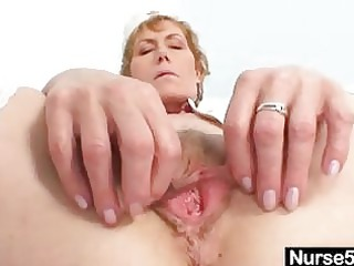 elderly milf self exam on gynochair with speculum