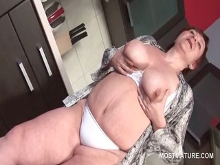 bbw older angel teasing her large bossom and