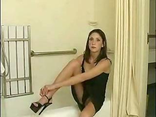 woman getting nude inside the bathroom