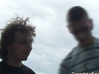 two buddies gang bang granny near lake