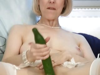 cougar lady fucks a cucumber