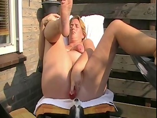 grown-up with saggy bossom pushing dildo and
