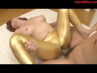 older girl into gold trousers taking her cave