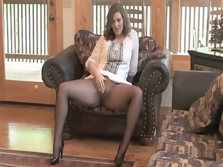 brunette girl sits on her chair inside nylons and