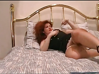 red-haired milf fist her wet vagina