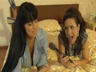 hot brunette woman gives an interview and a wet