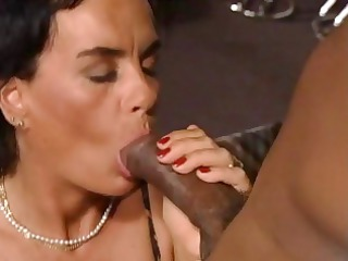 brunette german woman eats a brown penis and gets