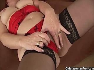 lewd elderly into stockings is pushing sex toy