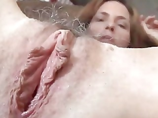 mature red-haired fucks her kitty and dolf