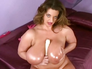 mega boobed oiled lady toys her hungry fat snatch